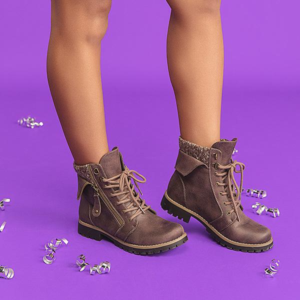 Woman Wearing Cliffs Pembroke Boots on Purple Background